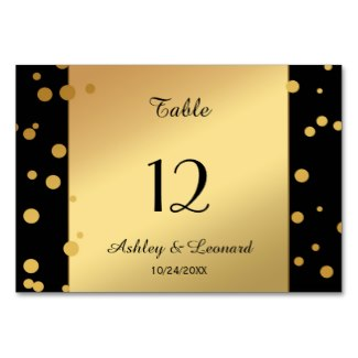Gold and black sparkling confetti table number card