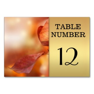 Chic gold table number card with colorful fall leaves