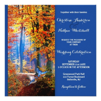 Blue wedding invitation with an enchanted fall forest with blue birds