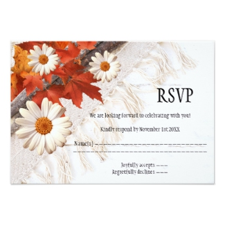 Wedding RSVP card featuring colorful fall leaves on a boho chic ivory background